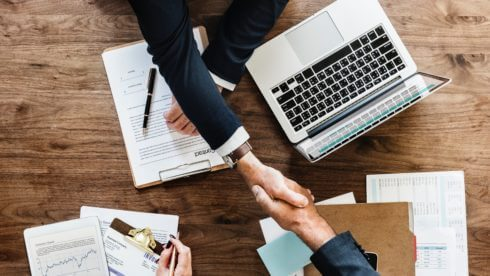 business shaking hands small business taxes swindells sussex