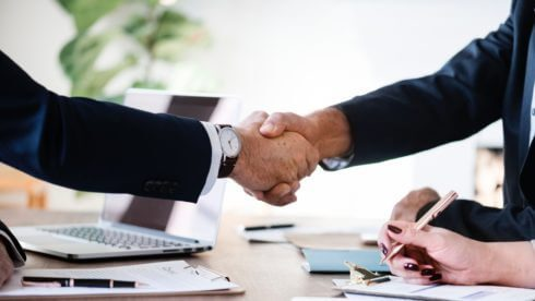 Two men shaking hands small business exit swindells planning